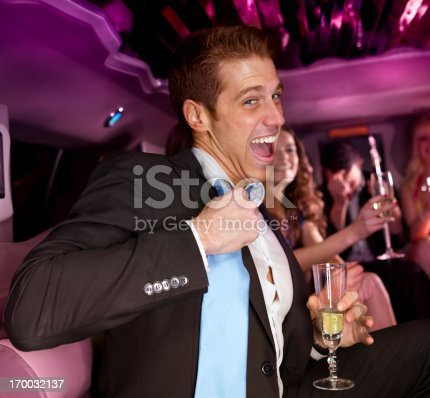 Young man in a suit having a good time at a party
