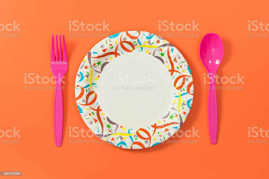 Party plate with spoon and fork stock photo