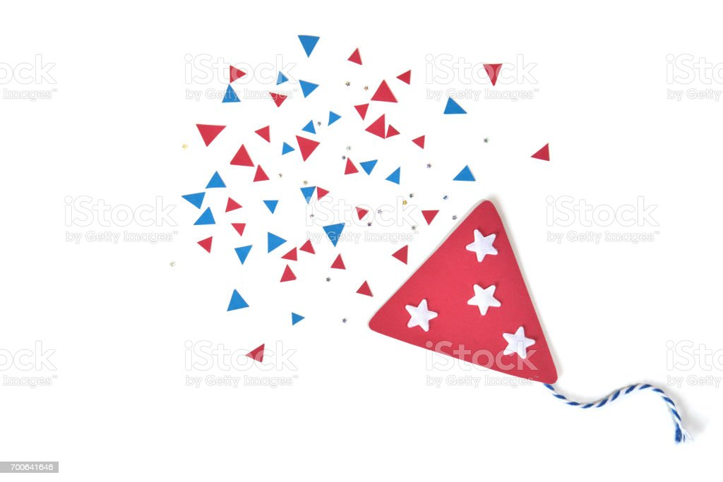 Party popper paper cut on white background - isolated stock photo