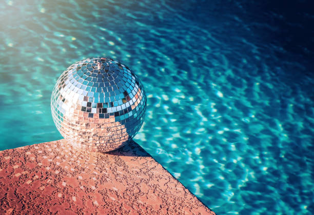 Party rave event disco ball beside swimming pool - Photo