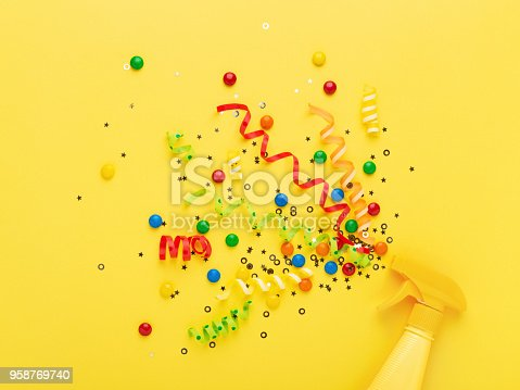 istock Party spray concept on yellow background. 958769740