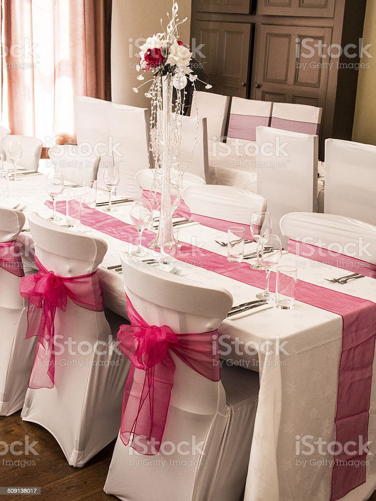 Party Table Decorated with Tall Floral Piece & Diamonds stock photo
