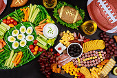 istock Party table for watching american football game. 1197580001