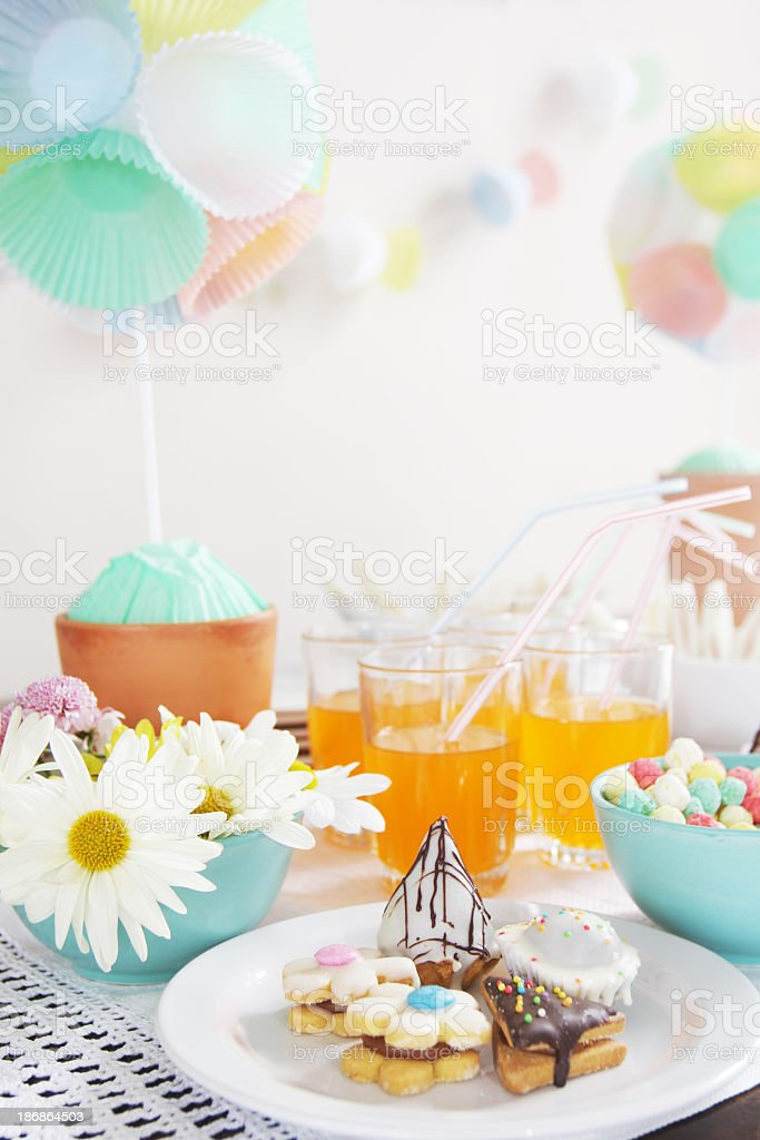Party table with cookies and daisies stock photo