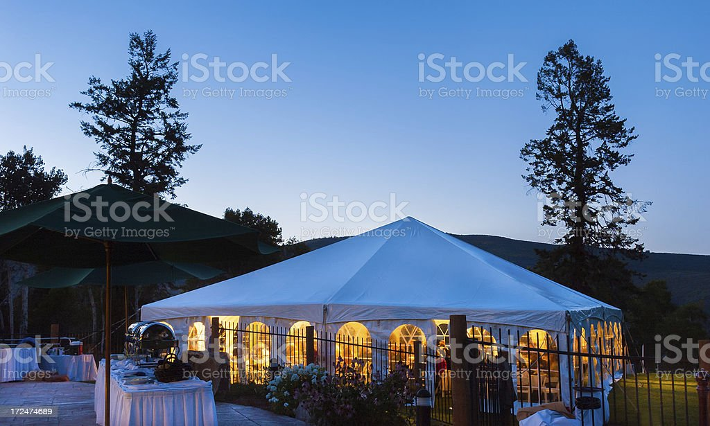 Party Tent Glowing Warm at Dusk with Cool Blue Light stock photo