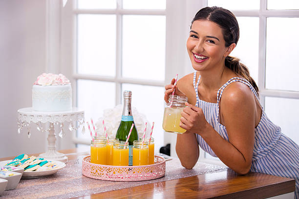 party theme get together women laughing smiling enjoying dessert decor - mimosa cake foto e immagini stock