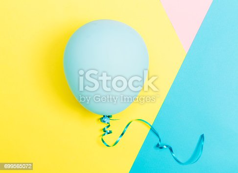 istock Party theme with balloon on a vibrant background 699565072