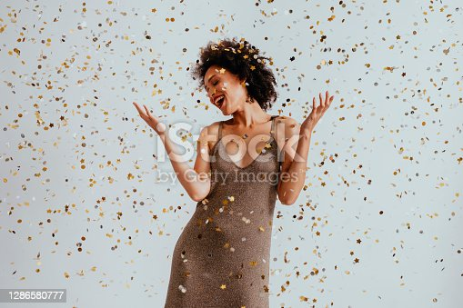 Beautiful smiling smartly-dressed woman dancing at a wedding reception