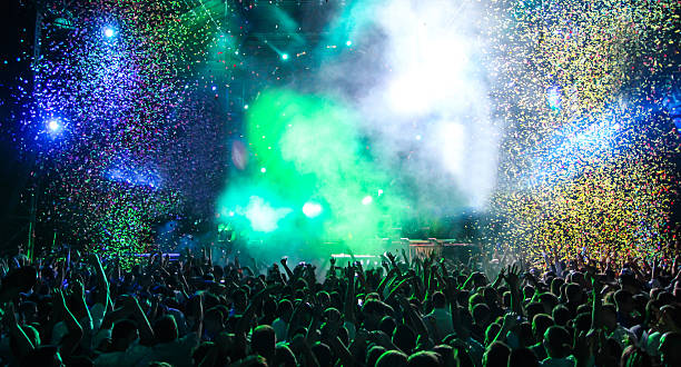 party with lots of confetti - popular music concert stock photos and pictures