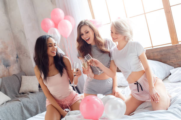 Party young women together having fun sitting on bed drinking picture id1163630870?b=1&k=6&m=1163630870&s=612x612&w=0&h=e8iokjdhykorvrbsb3bhiss5jd mtxhwyyhbucrssfw=