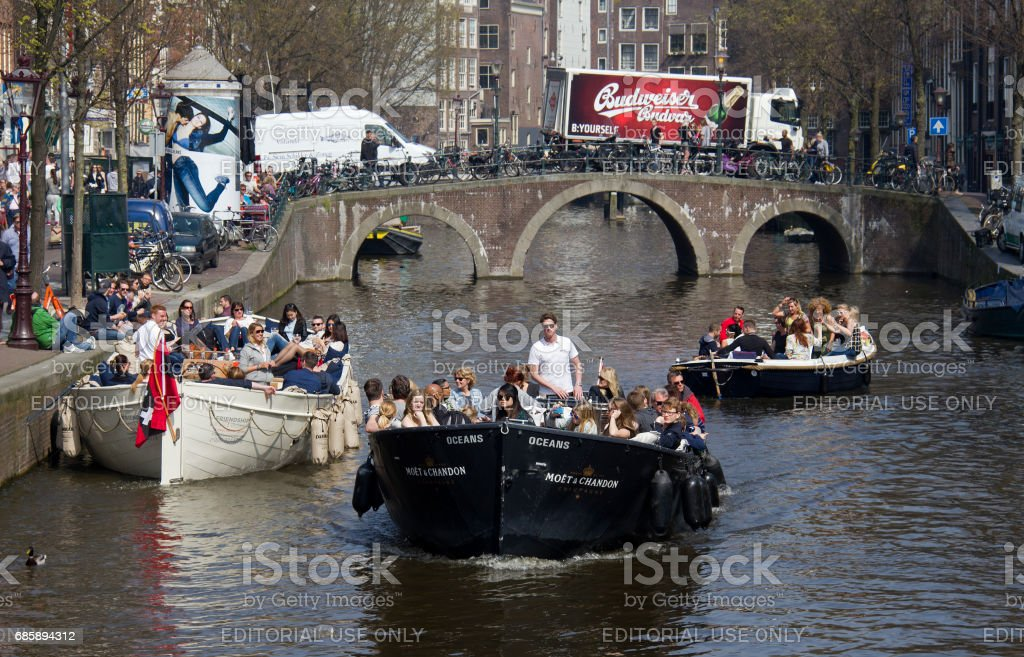 Partyboats in Amsterdam stock photo