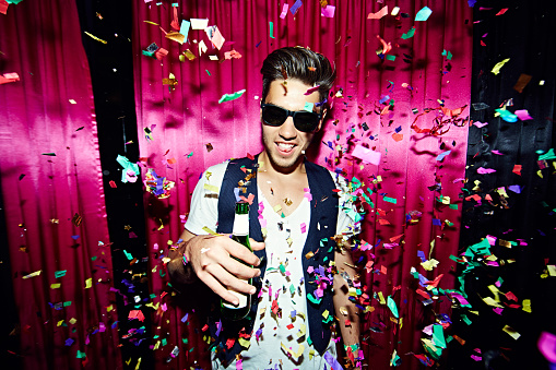 Partygoer In Confetti Stock Photo - Download Image Now - iStock