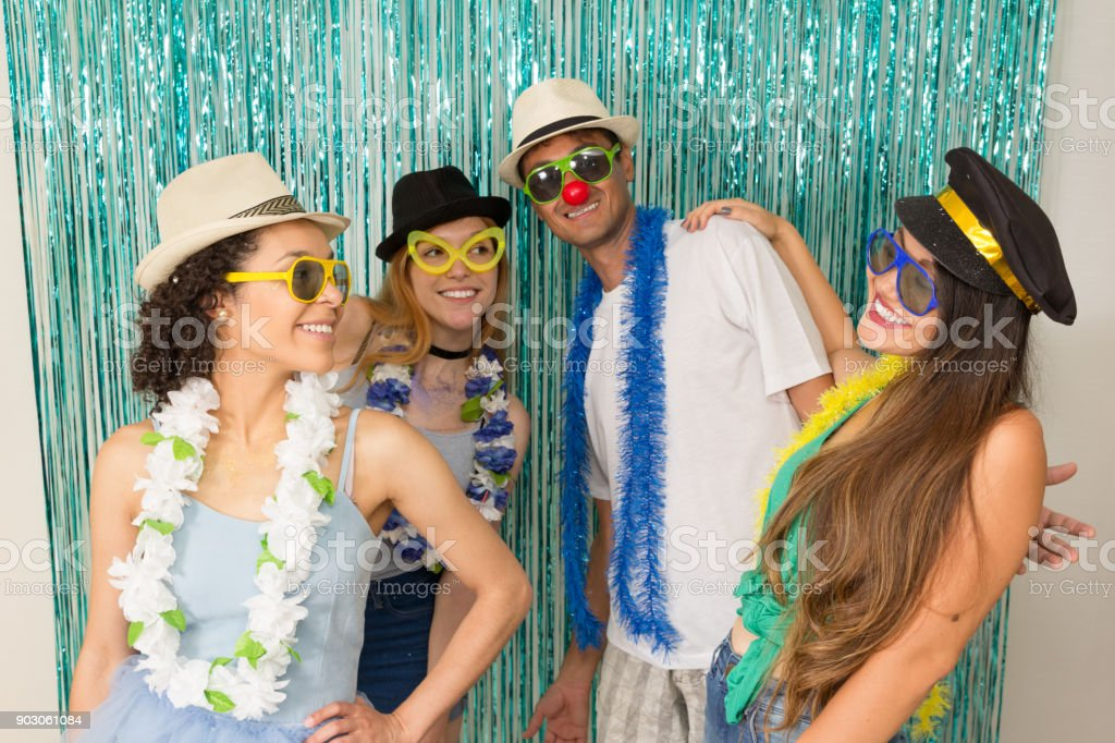 Partygoers are celebrating Carnival in Brazil. Friends are dancing Carnival songs.'n stock photo