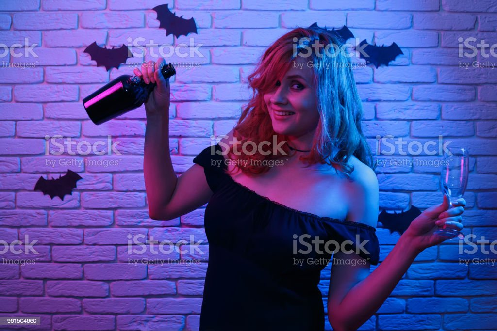 Young gothic girl bottle