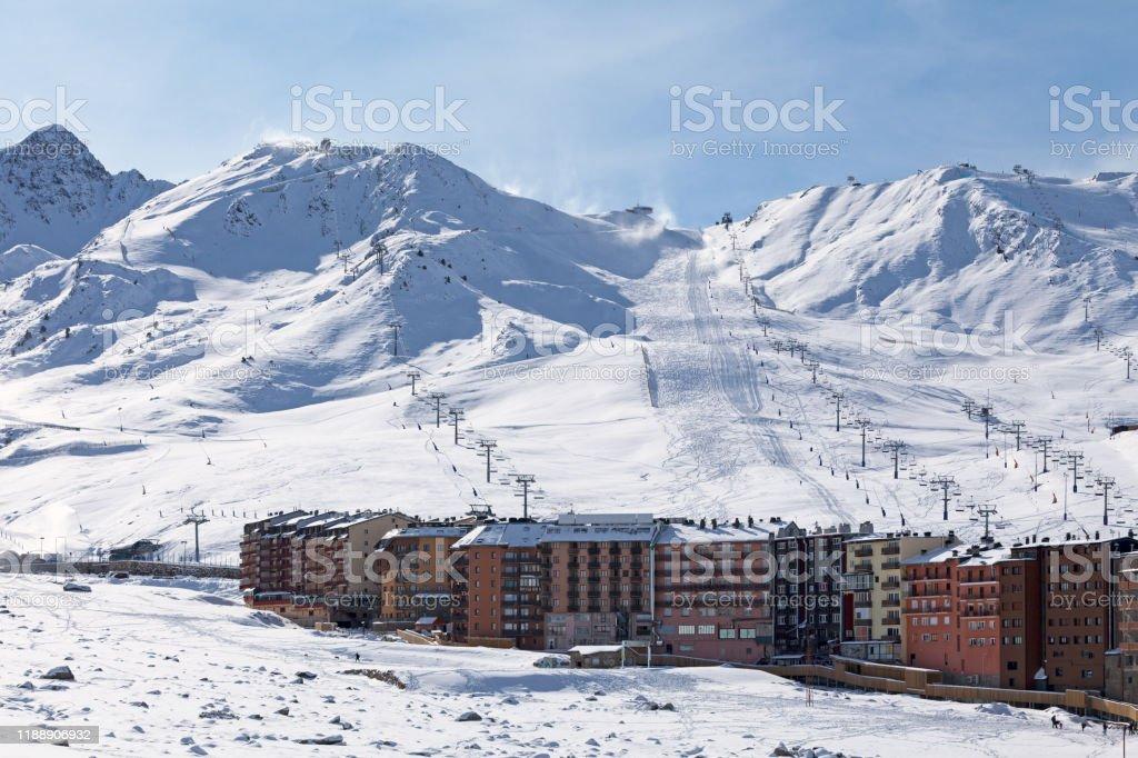 Pas de la Casa in Andorra Ski lifts heading toward the top of the snow-capped mountains of Grandvalira from Pas de la Casa (Andorra). Aerial View Stock Photo