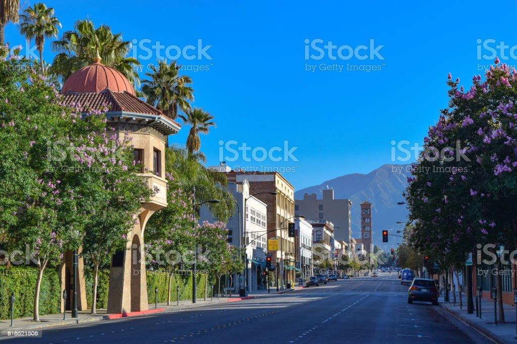 Pasadena, California Street Scene An empty street in downtown Pasadena, California with palm trees and retail stores. Architecture Stock Photo