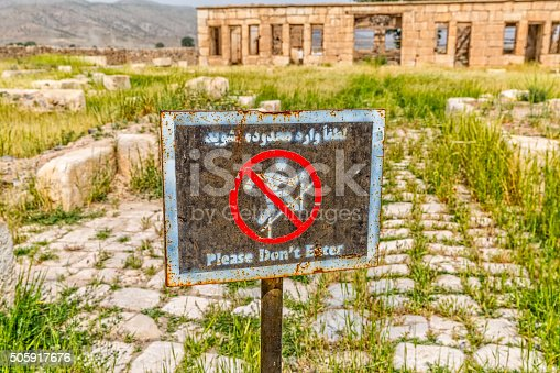 Sign infront of the Mozaffarid caravansarai, part of the old archaeological site near the tomb of Cyrus the Great in Pasargad Iran.