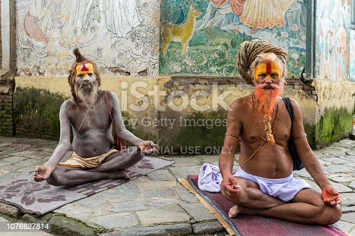 Two Sadhus meditating in the Pashupatinath Temple, the most famous and sacred Hindu temple complex, a UNESCO World Heritage Site located on the banks of the sacred Bagmati River, Kathmandu Valley, Nepal. Photo taken on 31 July 2018.