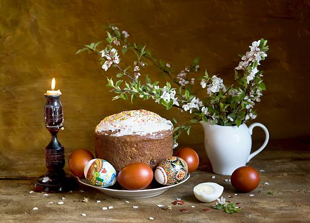 Paska (traditional Ukrainian Easter cake) and Easter eggs stock photo