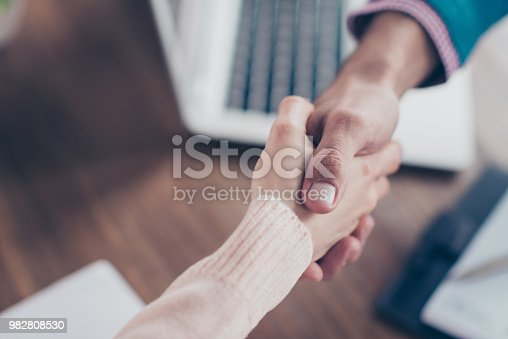 istock Pass a job interview - close up cropped portrait of shaking hands of successful businessman and candidate, hire a job, making a contract, having a deal 982808530