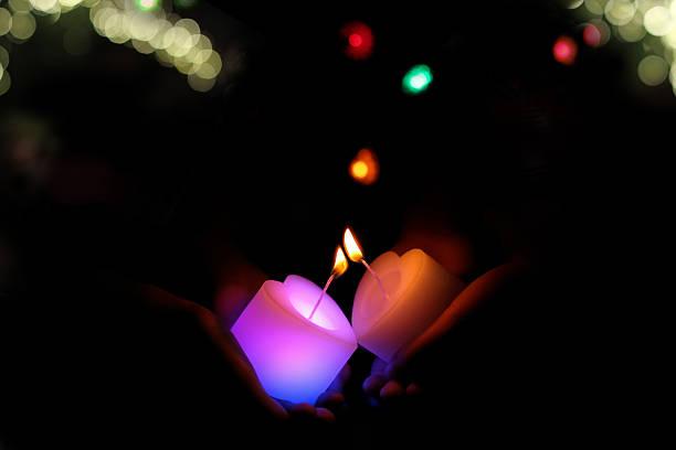i pass the flame of the candle. - hand tänder ett ljus bildbanksfoton och bilder