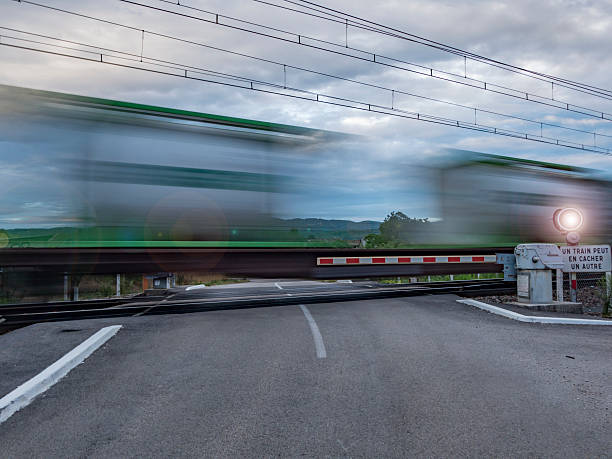 passage of a train - railway signal stock photos and pictures