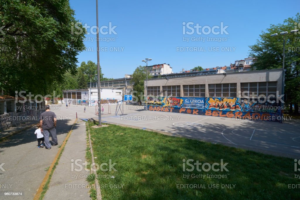 Passage to school yard stock photo