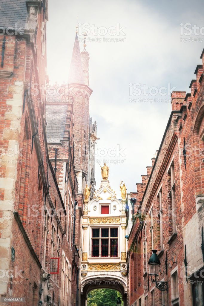 Passage to the Burg square in Bruges between the town hall on the left and the ancient civil registry on the right stock photo