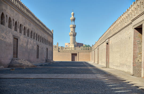Passages surrounding Ibn Tulun mosque with minaret of Amir Sarghatmish mosque at far distance, Sayyida Zaynab district, Cairo, Egypt stock photo