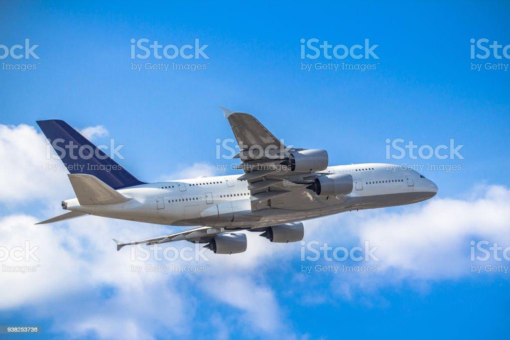 Passanger airplane taking off stock photo