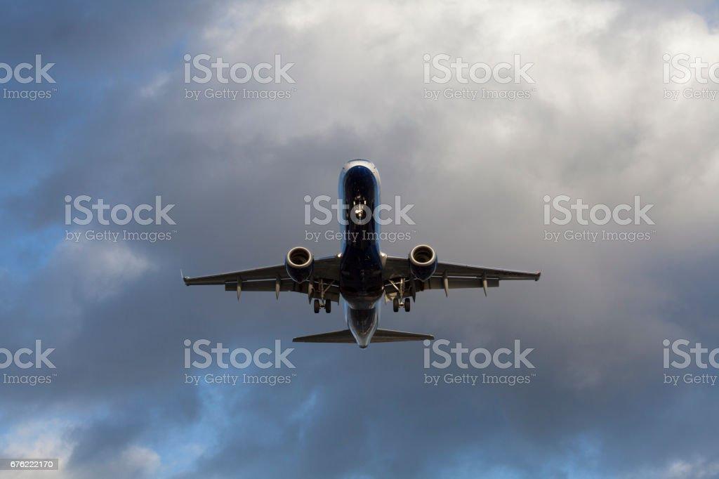 Passanger jet airplane landing stock photo