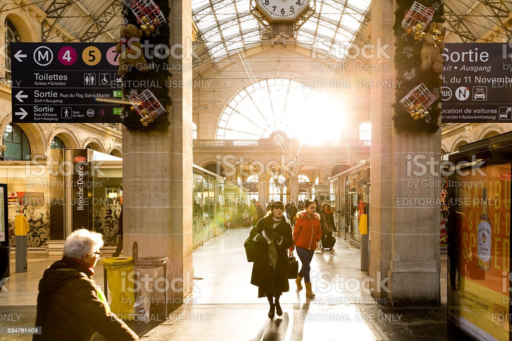 Passangers walking on the Gare du Nord Station in Paris. stock photo