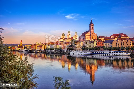 The waterfront and sightseeing boats in Passau at sunset.