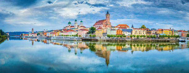 Passau city panorama with Danube river at sunset, Bavaria, Germany Panoramic view of the historic city of Passau reflecting in famous Danube river in beautiful evening light at sunset, Bavaria, Germany european culture stock pictures, royalty-free photos & images