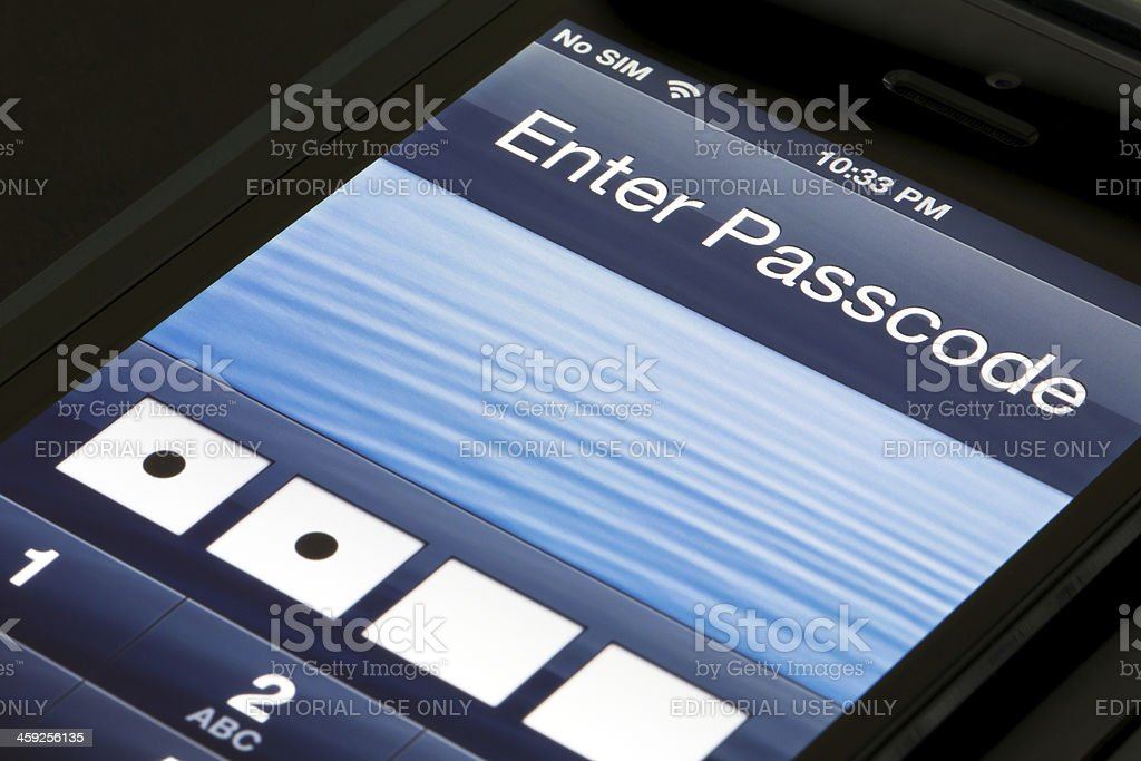 Passcode screen on the Apple iPhone 5 stock photo