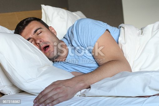 istock Passed out man drooling in bed 957318582
