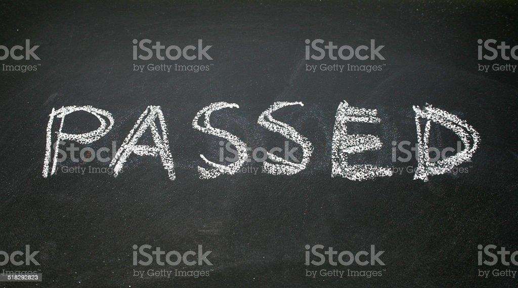 passed written with chalk on blackboard stock photo