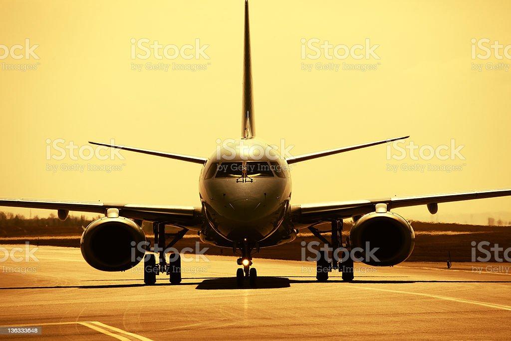 Passenger Aircraft at Dusk royalty-free stock photo