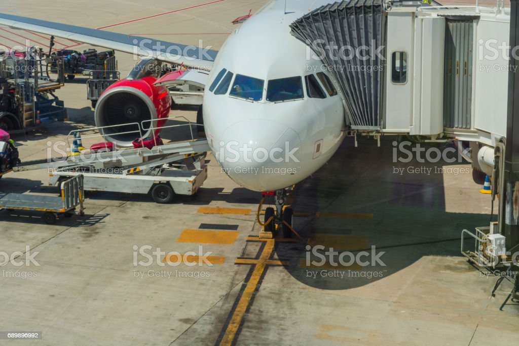 Passenger aircraft during loading and refueling stock photo