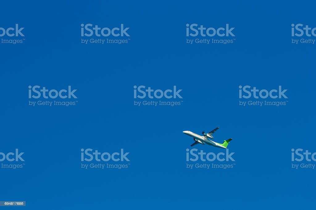Passenger aircraft in the sky stock photo