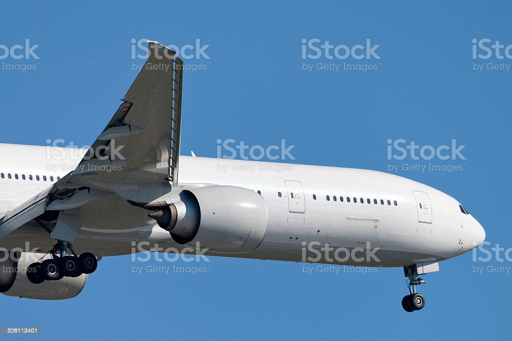 Passenger aircraft on approach to land stock photo