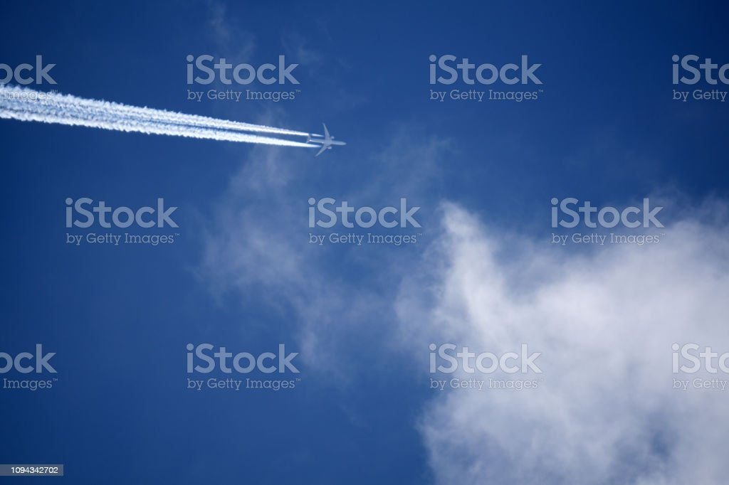 Passenger airliner flying in low visibility rainy sky, high risk of...