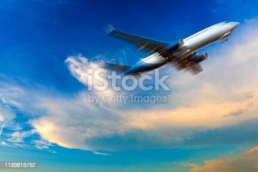 816320512 istock photo Passenger airliner taking off in cloud landscape at sunset 1133815752