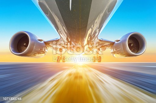 Passenger airplane accelerates at high speed view from below with bright light
