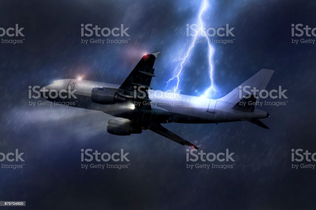 passenger airplane being hit by a lightning in a storm mid air stock photo