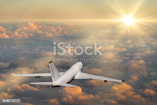155439315istockphoto Passenger airplane flying above clouds during sunset 648015222