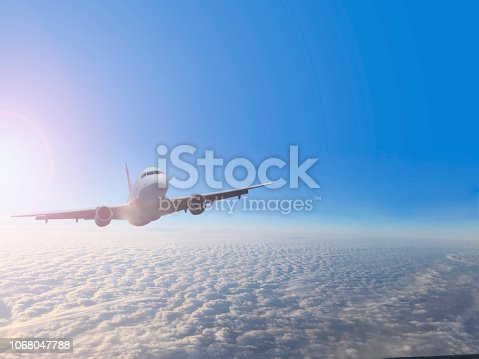 943681768 istock photo Passenger airplane flying above clouds 1068047788