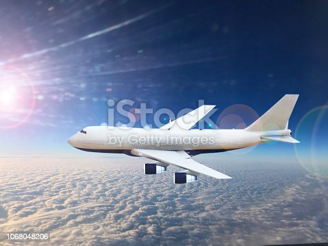 943681768 istock photo Passenger airplane flying above clouds. 1068048206