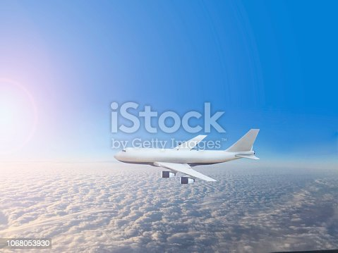 943681768 istock photo Passenger airplane flying above clouds 1068053930