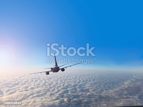 943681768 istock photo Passenger airplane flying above clouds 1068054644
